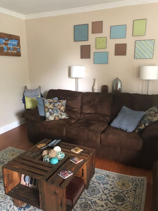 Living room is perfect for entertaining! Comfy couch and love seat and a TV to unwind after your day!