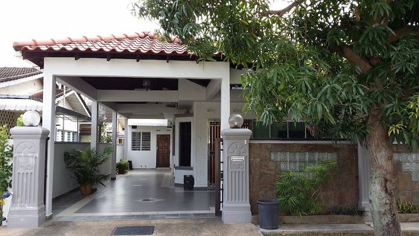 Guesthouse main entrance with a car porch which can park up to 3 cars
