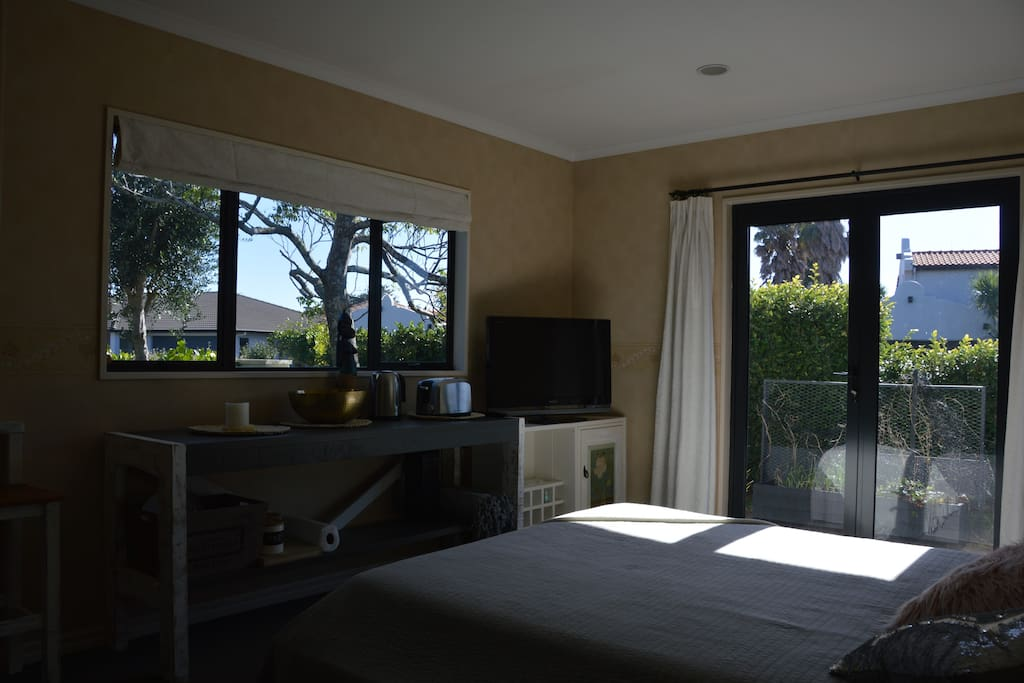 Light, sunny and warm guest bedroom