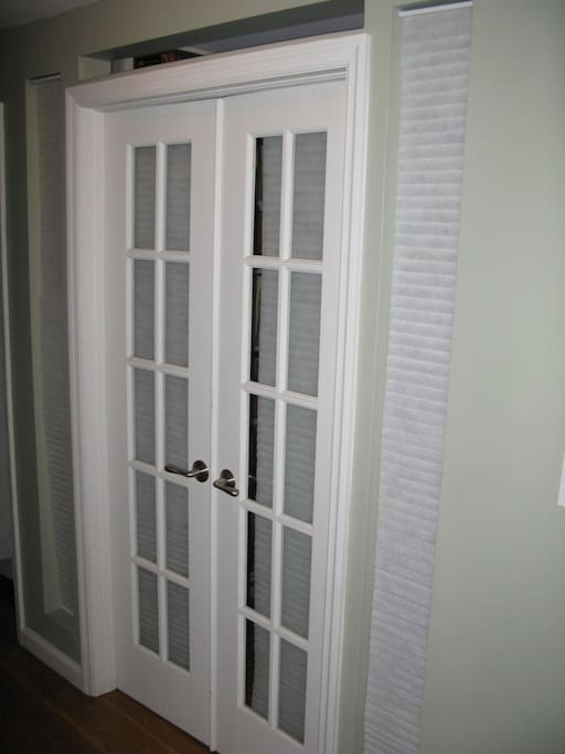 French doors to middle room and library.