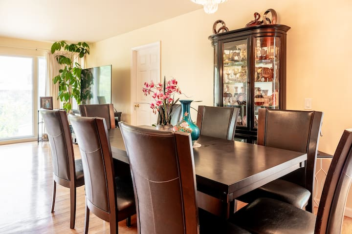A dining table with 8 seats