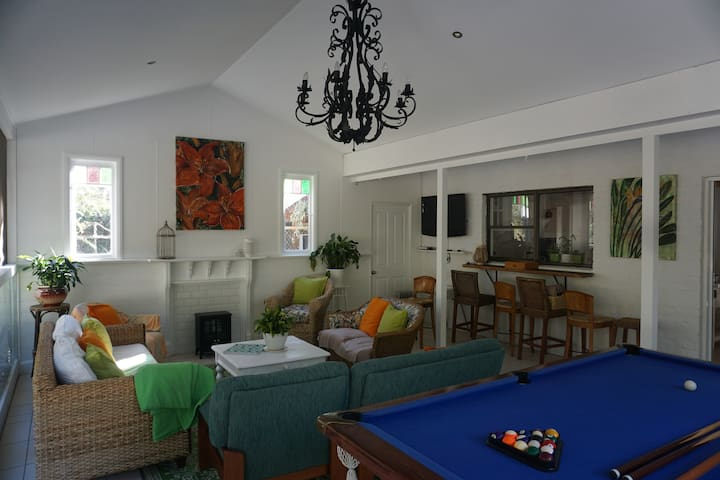 """Guests are able to use our """"Garden Room"""".The space may be shared with other guests. Watch TV , play pool, read, work, eat or simply relax and watch the birds in the trees. Step outside and use the barbeque, table tennis, or take a dip in the pool!"""
