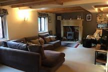 Main lounge with log burner, TV.