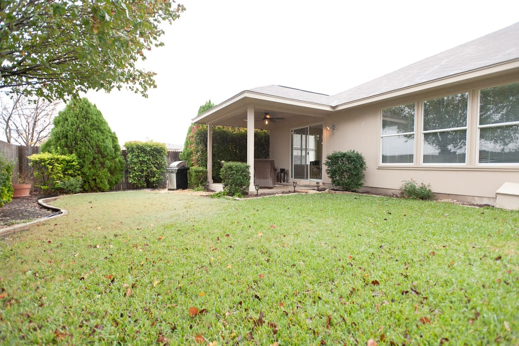 The backyard is truly fantastic with professional landscaping, covered patio with entertainment system, grill, and no neighbors to the rear of the home.