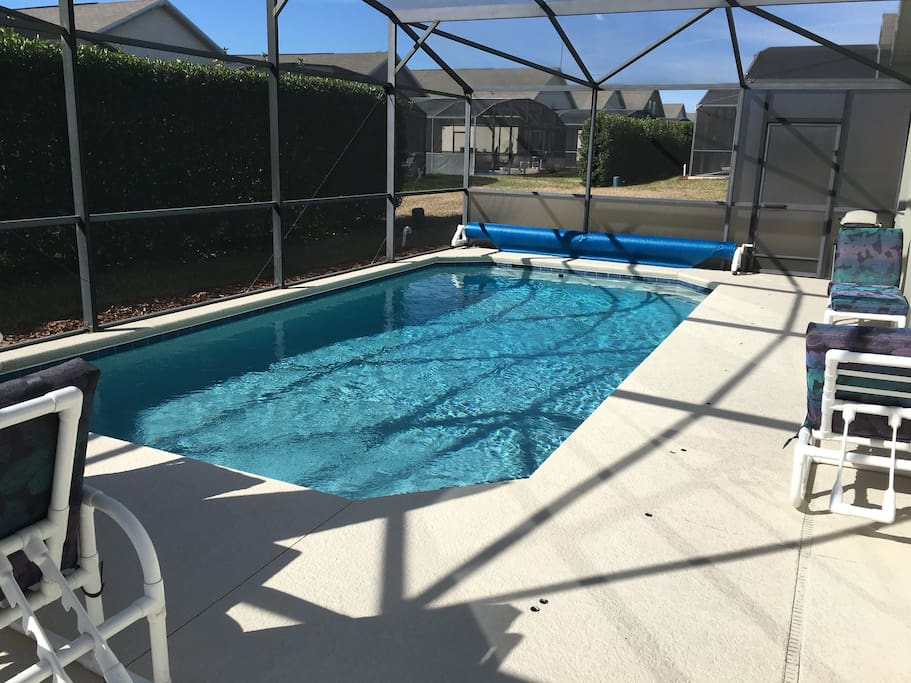 2 comfortable lounges, big table with umbrella, large pool