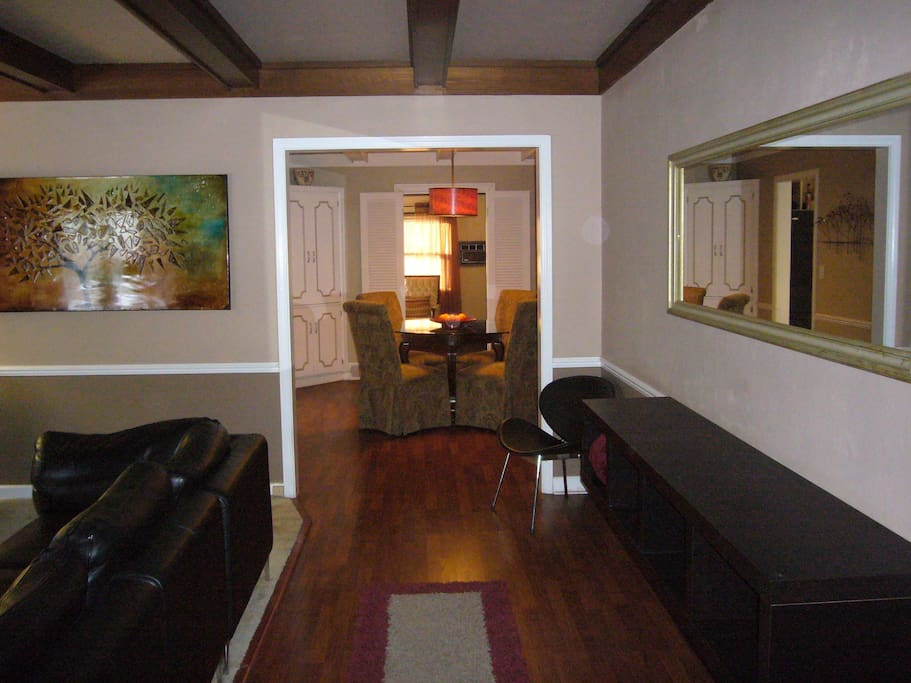 From the entryway, looking past the living room into the dining room.