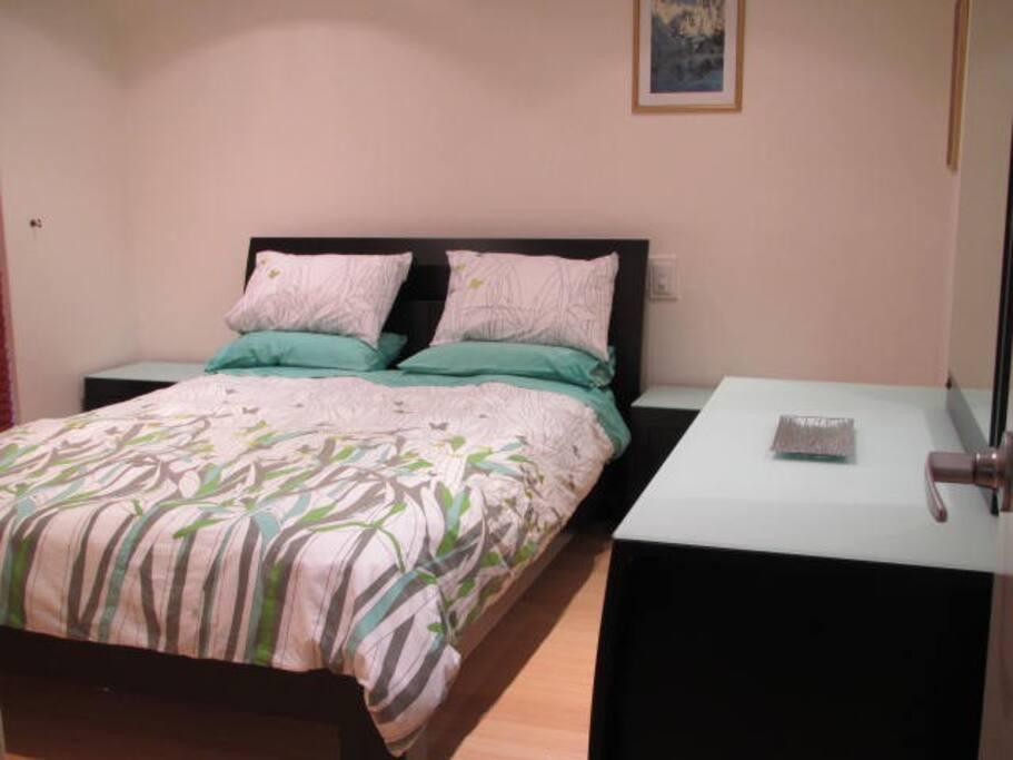 Master Bedroom with built-in robes & adjoins bathroom