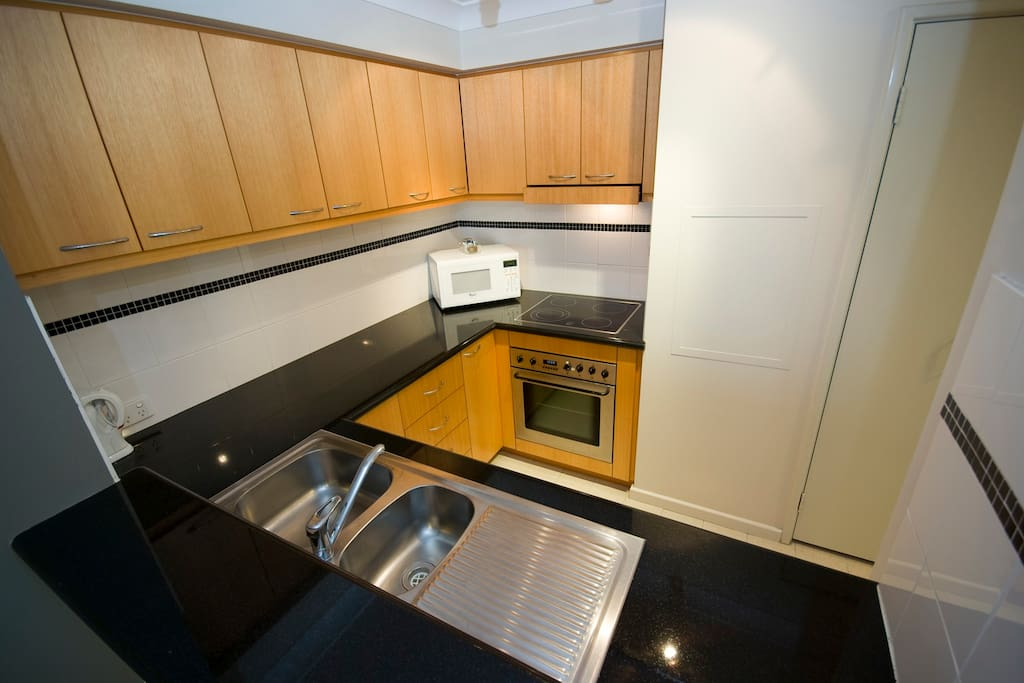 Full kitchen with microwave, oven and dish washer