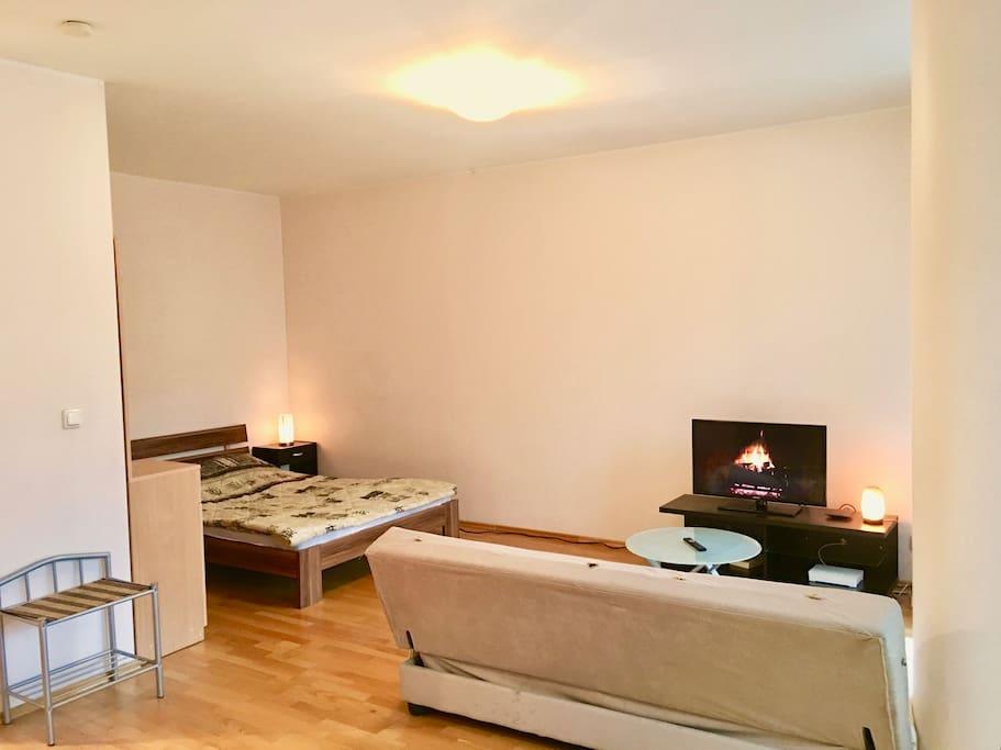 The bedroom/TV corner