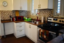 Kitchen all furnished with stove, refrigerator, microwave, toaster, Coffeys maker, blender, pans and dishes.