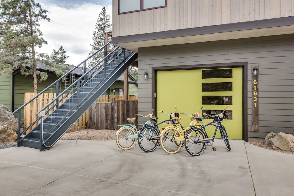 Single stall garage and 4 cruiser bikes included.  Stairs shown are to the attached apartment that may be rented separately