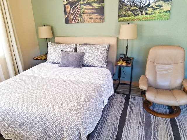 Comfy queen bed with side tables.