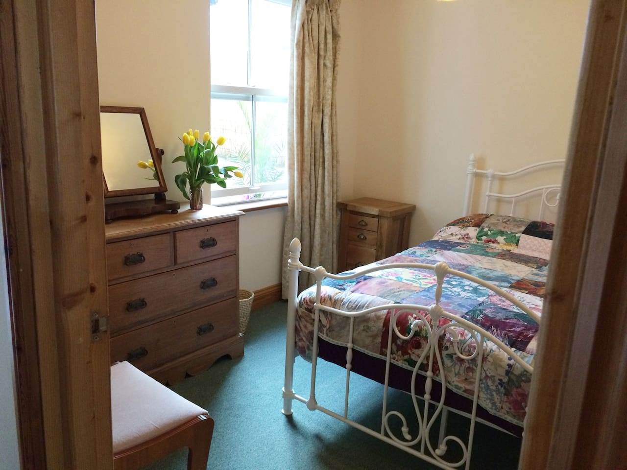 Double bedroom with double glazed sash window looking out to private patio.
