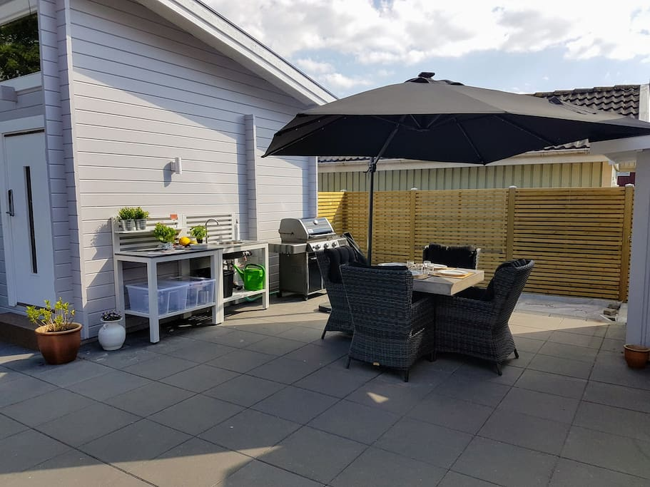 Outdoor kitchen, gas grill and garden dining area