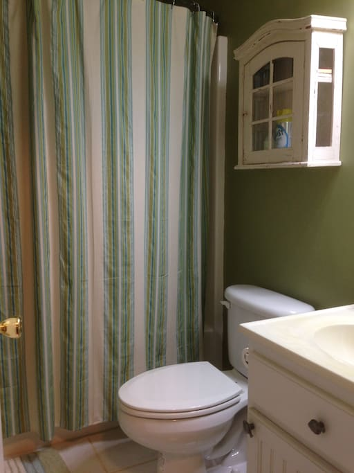 Bath or shower. There is also an extra 1/2 bath located down  stairs.