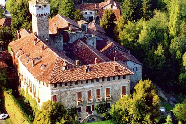 A guest house in a medieval hamlet next to a castle.