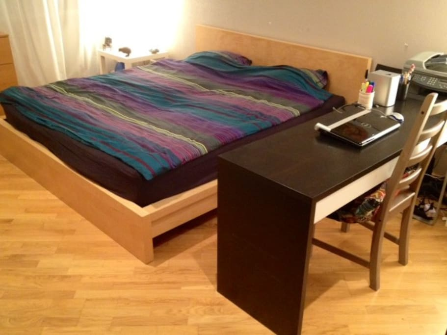 Bedroom: king-size bed with brand-new mattress, wardrobe, sofa, desk, dresser, arm-chair, TV, AC
