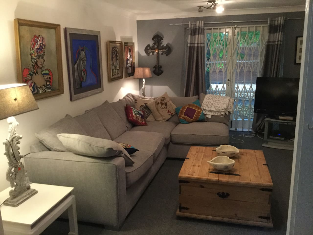 Sitting room with patio doors very safe quiet area also very pretty.