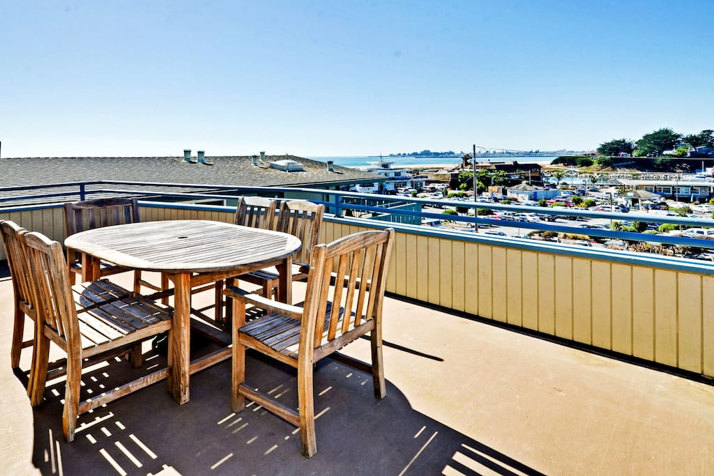 The deck has views of Twin Lakes Beach and the Harbor