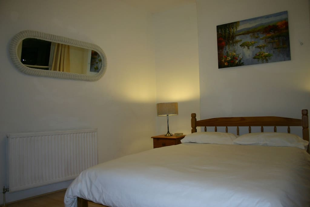 Comfortable and spacious double bedroom  with a king size bed - additional bedding is provided for extra person