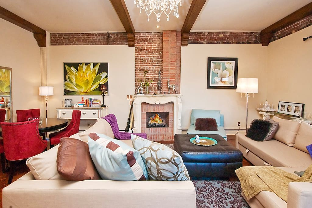 LIVING ROOM WITH GAS FIREPLACE AND CHANDLIER