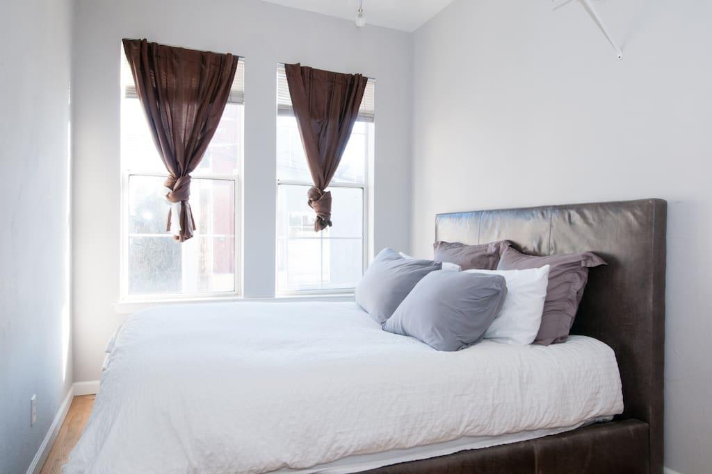 Bedroom. New queen bed w/ comfortable, pillow top mattress.