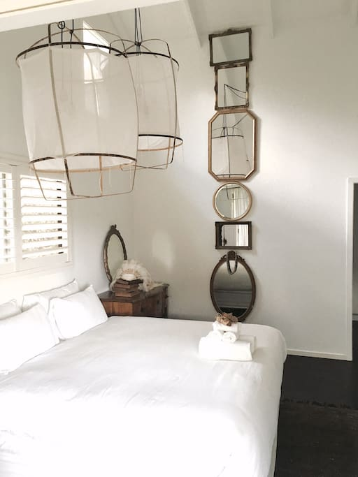 The master suite is adorned by antique mirrors layered down the 8 meter ceiling