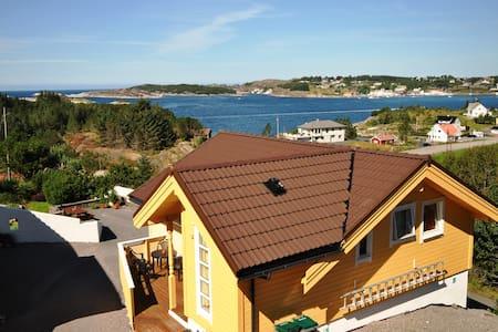 Hus med havutsikt og båt - Steinsland - Rumah