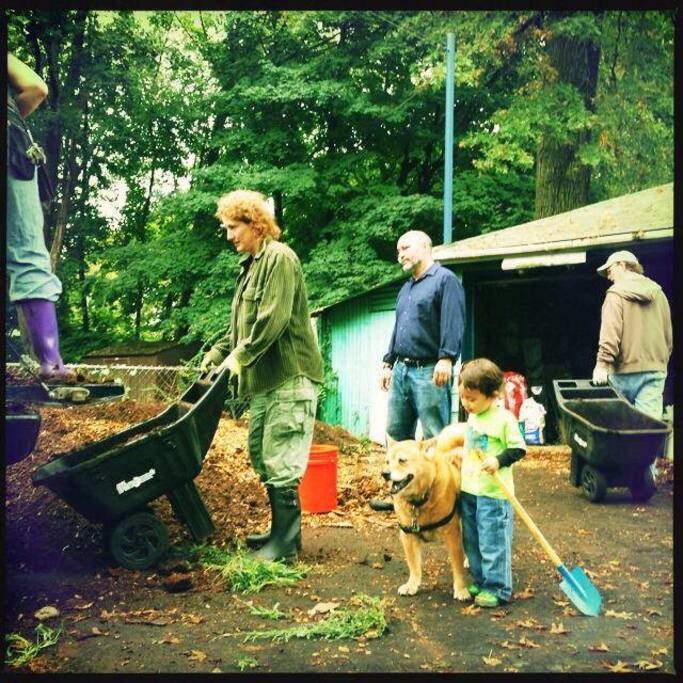 Neighborhood team here building our first hugelkultur, a permaculture raised bed.
