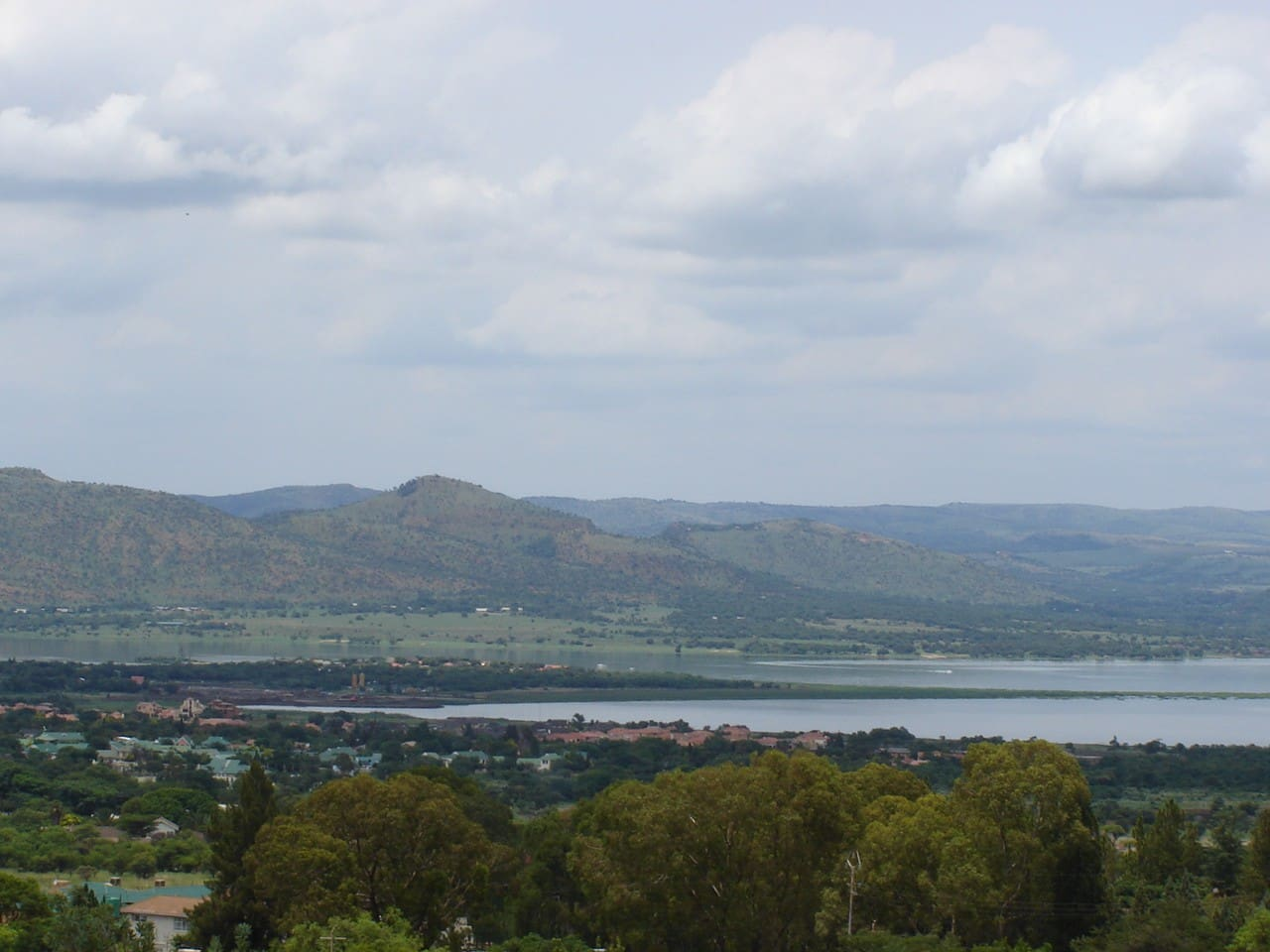 View of Hartbeespoortdam and surrounding area as seen from Coucal Cottage.