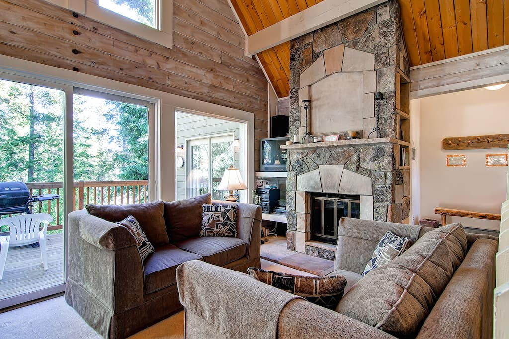 The wood and stone finishes blend perfectly with the great views in this comfortable living space.