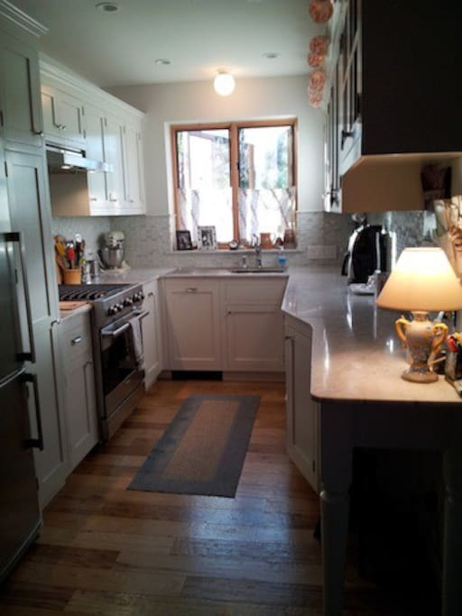 Well equipped kitchen has Viking range and Miele dishwasher.