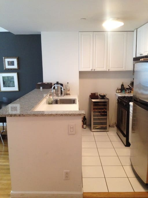Kitchen with walk-up counter bar, Dishwasher, Microwave and Stove