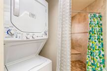 Washer & Dryer in the downstairs bathroom. All stocked with laundry detergent for you too!