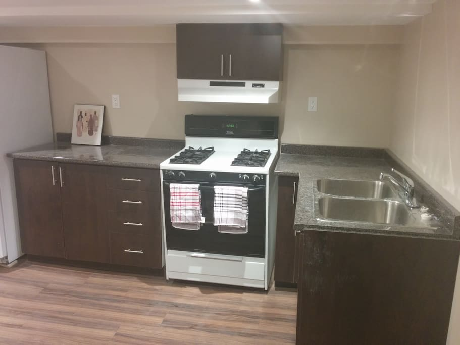 Spacious kitchen with gas stovetop/oven. Fully stocked with cookware, dishes and cutlery.