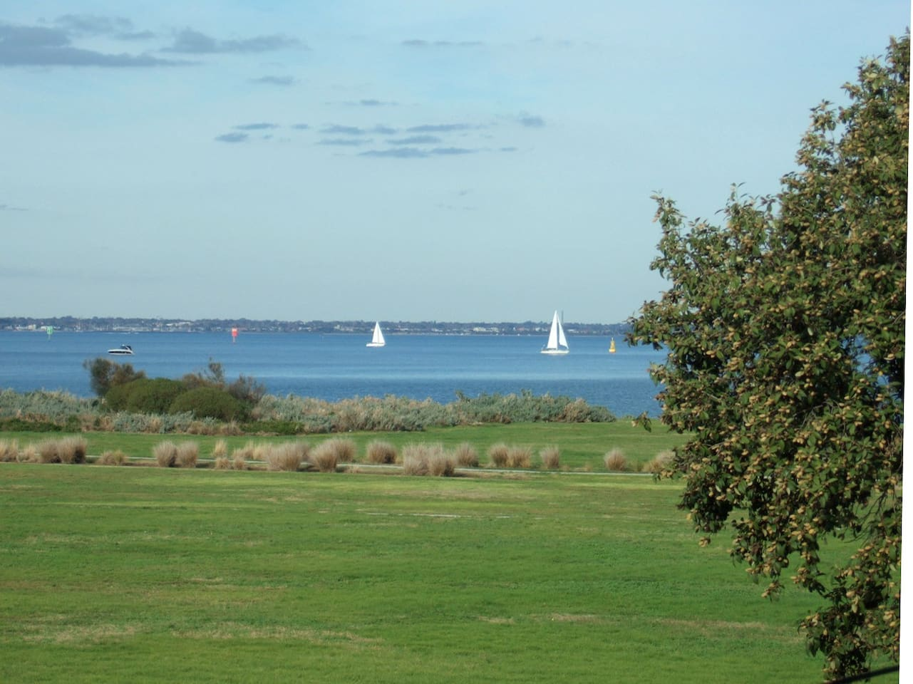 View from bedroom across Point Gelibrand Park and Hobsons Bay.