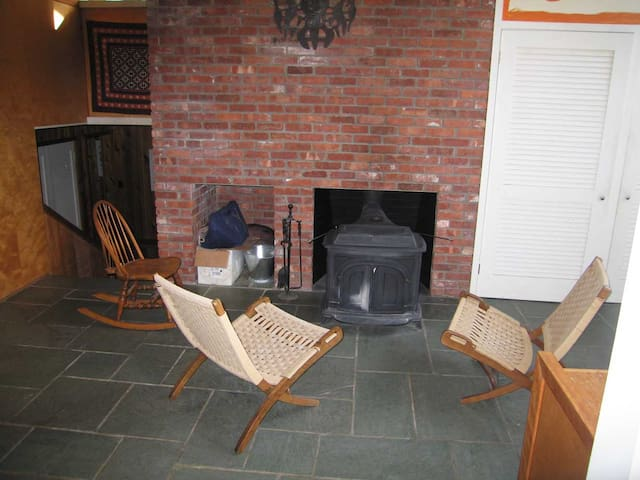 Vermont castings wood burning stove in foyer