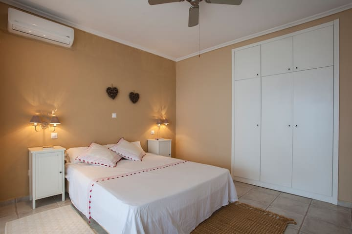 Master bedroom with large in-walled closet, A/C and ceiling fan