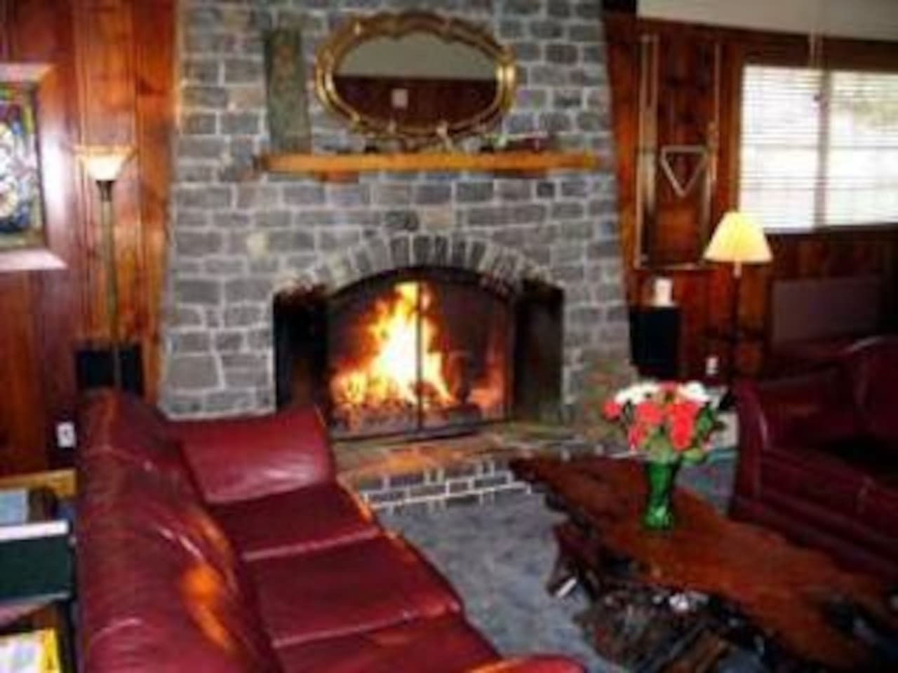 Living room with stone fireplace--cozy comfort!