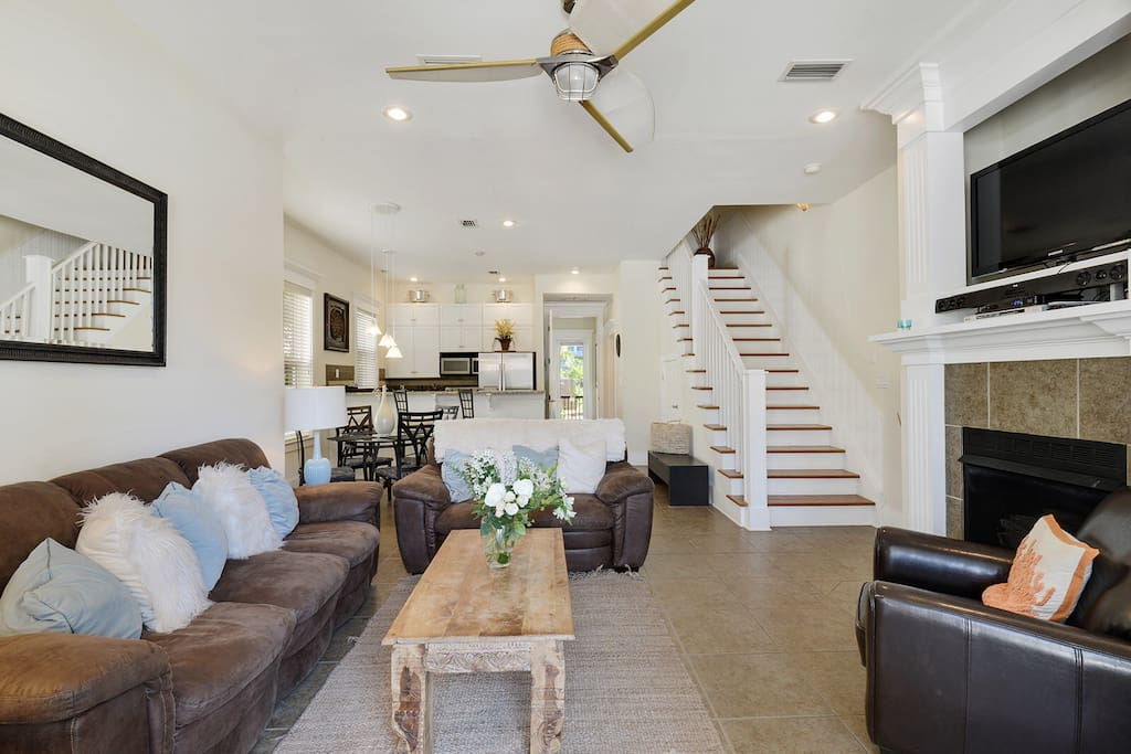 The downstairs has an open floor plan with lots of natural light, cable TV and a fireplace in the living room. The kitchen and dining room and one bedroom and bath are also downstairs.