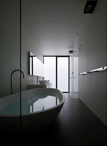 Main bathroom with Agape bath for a relaxing soak after a long day sightseeing in Tokyo.