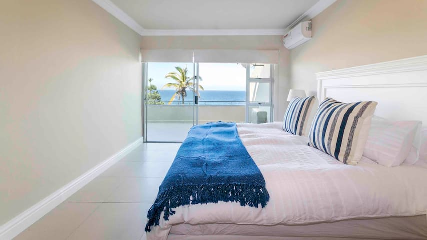 Beautiful master en-suite bedroom with King size bed. Wake up with views of the ocean and door leading to the large balcony