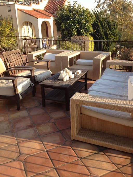 Patio furniture on terrace.  Great for dinners at sunset.