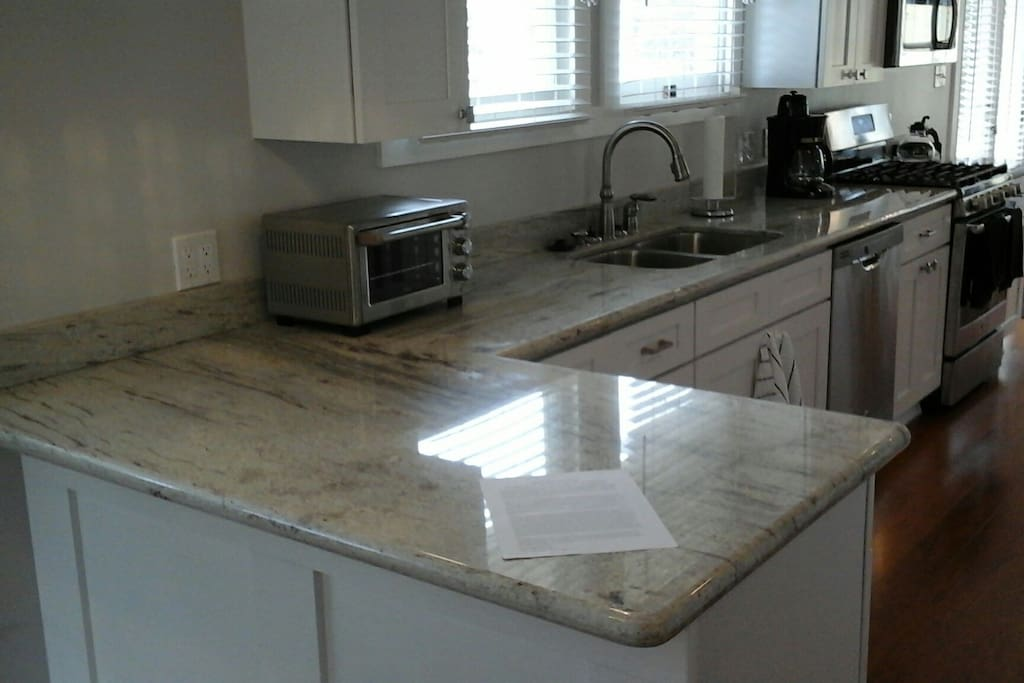 Kitchen features new appliances and granite counter tops