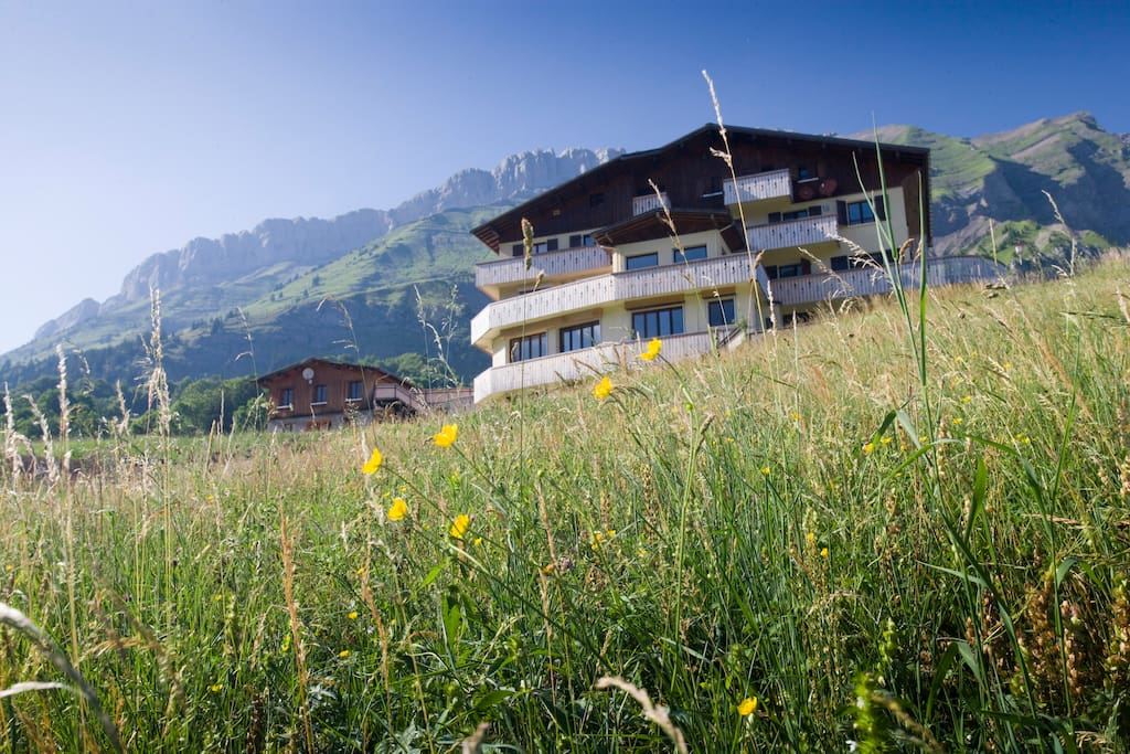 The chalet overlooks the meadow and valley