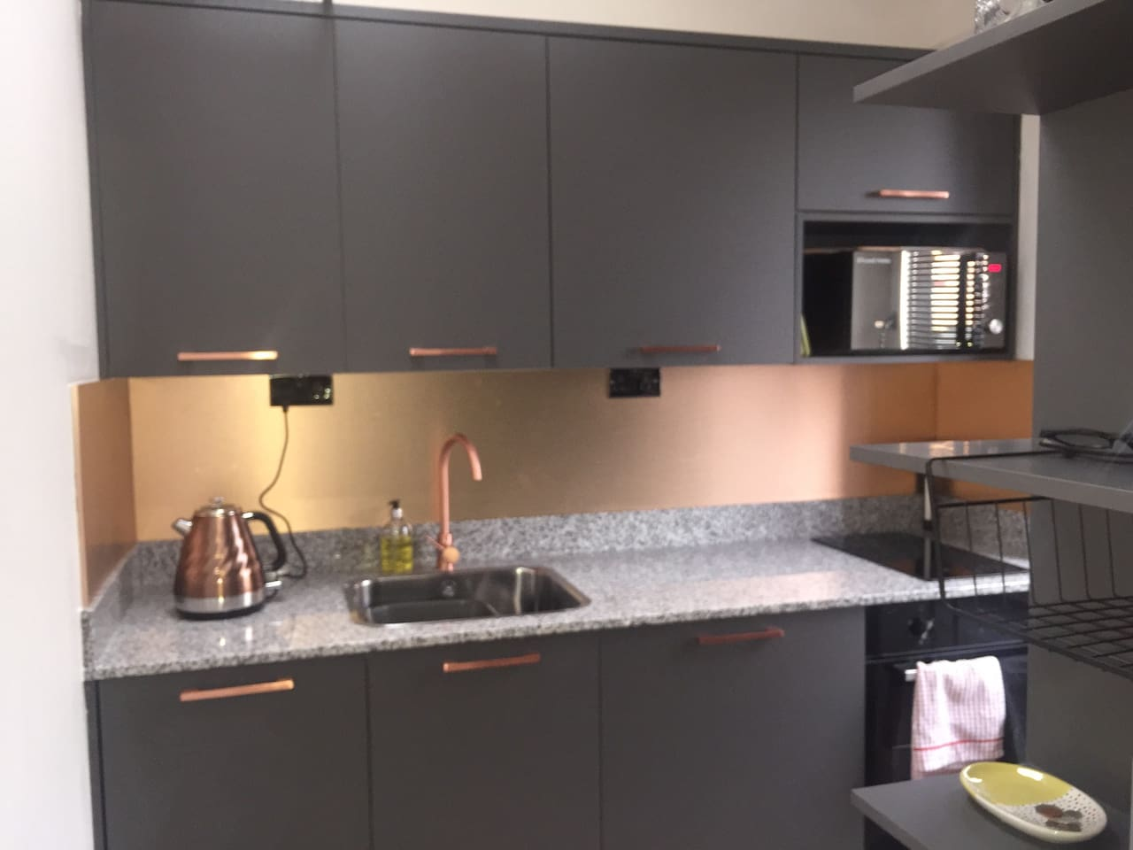 Luxury compact kitchenette with granite worktop. Integrated dishwasher and washing machine included.