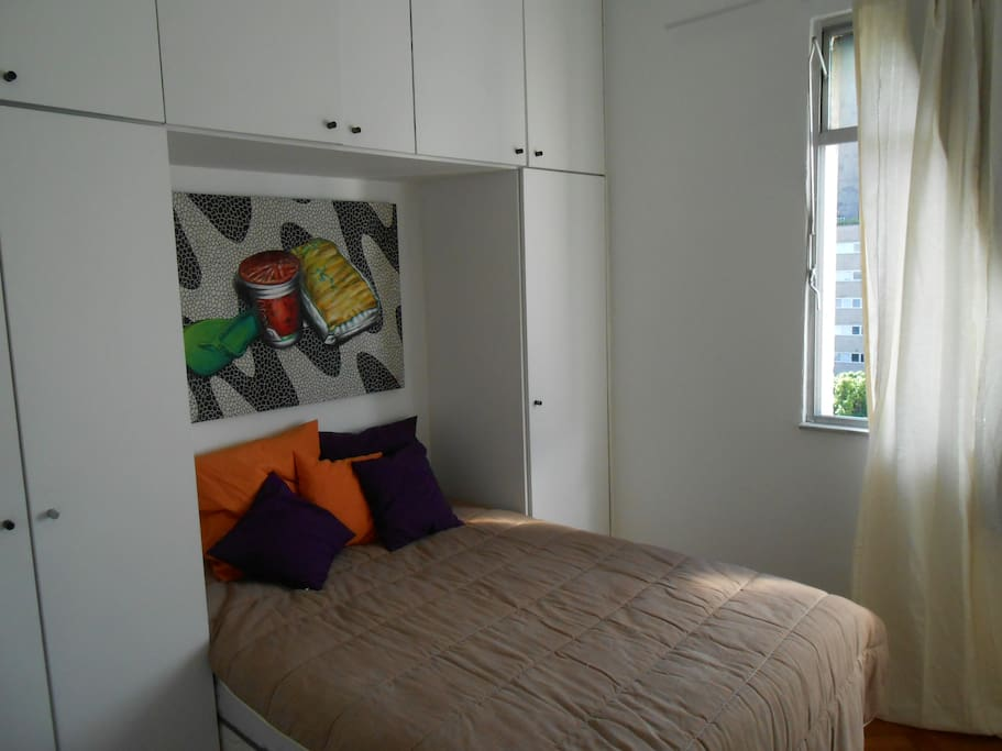 Second bedroom:  smaller than the first bedroom, but just as comfortable and full of light.