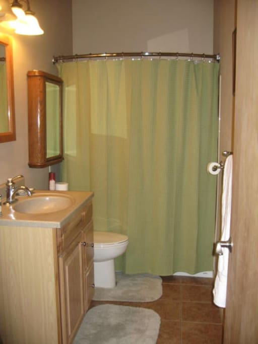 Full bathroom with tub for relaxing after a long day in the mountains.