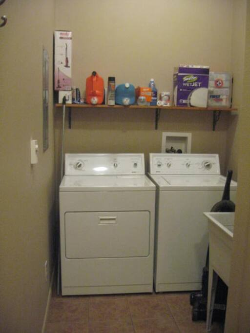 Full laundry with dryer, washer and basin for use.