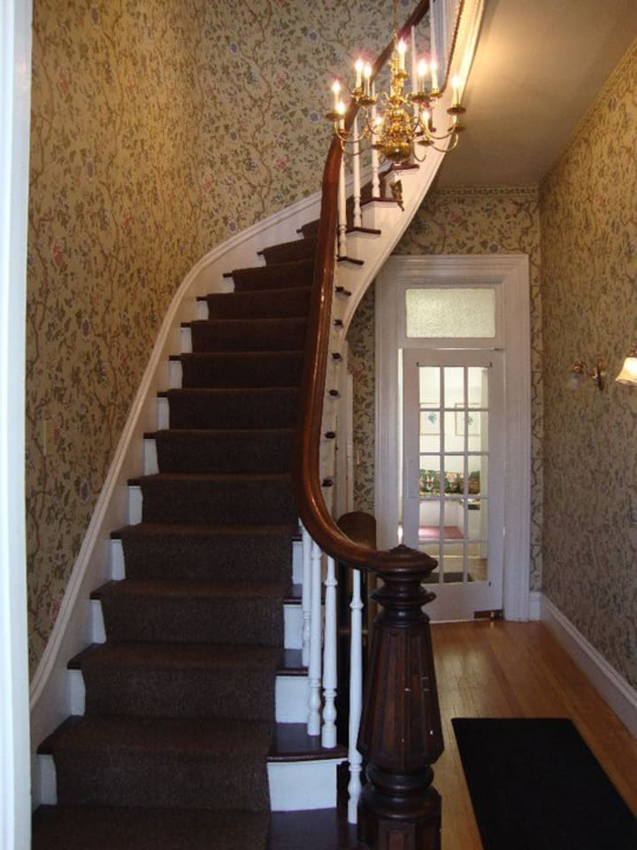 Lovely staircase leading to the private suite.